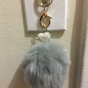Grey large Pom Pom keychain.